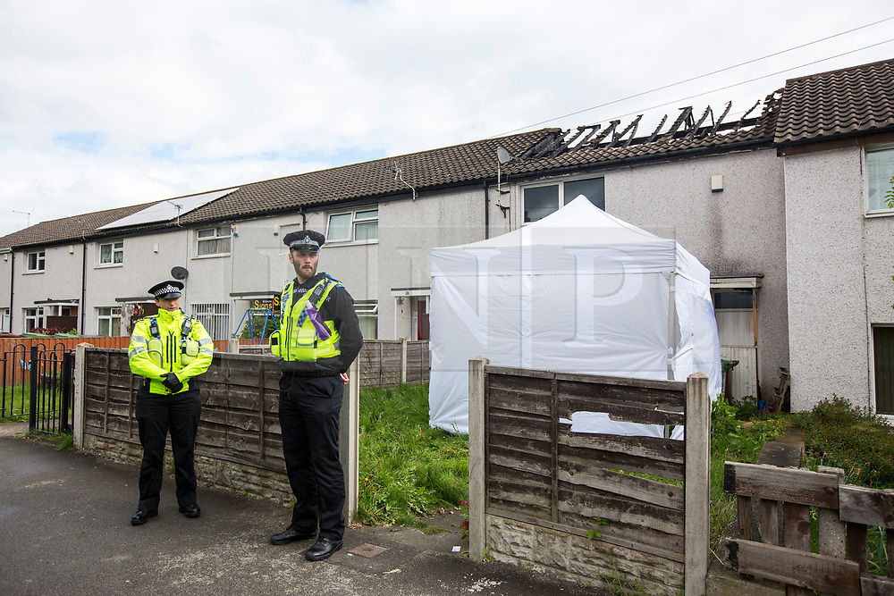 © Licensed to London News Pictures. 27/04/2017. Leeds UK. Picture shows police at the scene of a house fire on Harehills lane in Leeds. A woman has been arrested after a man died following a house fire on Harehills Lane in Leeds early this morning. A man found at the scene was treated by firefighter and paramedics but was pronounced dead at the scene. A 28 year old woman has been arrested on suspicion of manslaughter & production of Cannabis after the remains of a cannabis growing set up were found at the property. Photo credit: Andrew McCaren/LNP