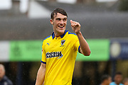 AFC Wimbledon defender Ryan Delaney (21) giving thumbs up during the EFL Sky Bet League 1 match between Southend United and AFC Wimbledon at Roots Hall, Southend, England on 12 October 2019.