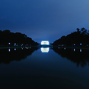 Night shot of the Lincoln Memorial reflected on a still Reflecting Pool.