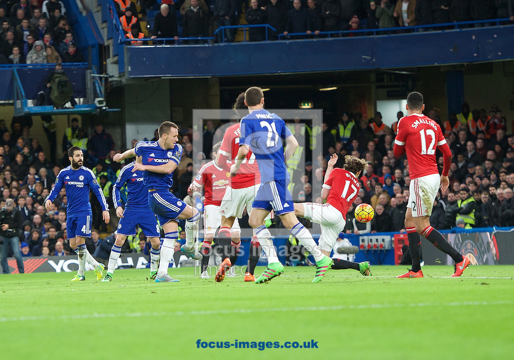 John Terry of Chelsea has a shot on goal which appears to hit Daley Blind of Manchester United on the arm but nothing is given byReferee Michael Oliver during the Barclays Premier League match at Stamford Bridge, London<br /> Picture by Alan Stanford/Focus Images Ltd +44 7915 056117<br /> 07/02/2016