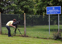 ©  licensed to London News Pictures KENT. UK. 28/04/2011. A television camera man films the sign at the Metropolitian police dog training centre in Bromley today (28 June 2011). An officer has been treated in hospital following the deaths of two police dogs who were left in a car on one of the hottest days of the year. The animals were found collapsed in an unventilated vehicle at the Metropolitan Police's training centre. Please see special instructions..Picture credit should read Grant Falvey/LNP.