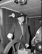 20/03/1959<br /> 03/20/1959<br /> 20 March 1959<br /> Gael Linn Singing competition in Newry, Co. Down. Captain Michael Hegarty, Moville, Co. Donegal, at the helm of his ship the M.V. Silverthorn of Liverpool on the morning after his visit to the Gael-Linn concert and singing competition at Newry Town Hall on the night of the 19th March.