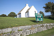 Holiday home sign and house, Ballyvaughan, County Clare, Ireland
