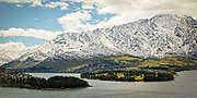 Snow-covered Remarkables and Queenstown, New Zealand