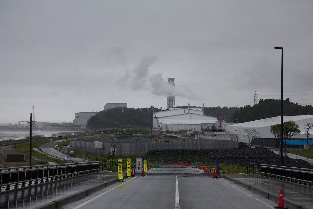 nuclear waste  storage and processing plant in fukushima Futaba-shi Tomioka Fukushima Daini Nuclear Power station in bacgrouod.