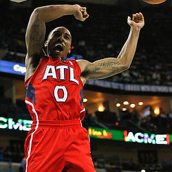 January 29, 2012; New Orleans, LA, USA; Atlanta Hawks point guard Jeff Teague (0) celebrates after a dunk against the New Orleans Hornets during a game at the New Orleans Arena. The Hawks defeated the Hornets 94-72.  Mandatory Credit: Derick E. Hingle-US PRESSWIRE