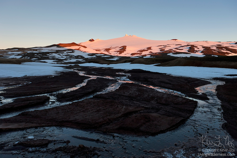 Melt water from the Snæfellsjökull glacier in Iceland creates small rivers down the mountain. Snæfellsjökull is a 1,446-meter (4,744-foot) stratovolcano located on the Snæfellsnes peninsula in western Iceland. The volcano last erupted in approximately 200 AD.