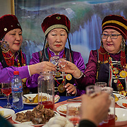 "New Year celebration by Buryati villagers living in Selenga in the Kabansk region along the shore at Russia's Lake Baikal. They live on the eastern shore and are descendants of Asiatic tribes, with Buddhist cultural influence. <br /> <br /> Crowned the ""Jewel of Siberia"", Baikal is the world's deepest lake, and the biggest lake by volume, holding 20% of the world's fresh water. In the winter, the lake 31,722 square meter surface is entirely frozen with ice averaging 2 meters thick."