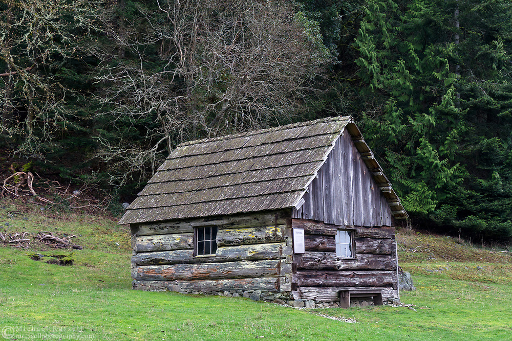 "This building has a plaque on the side calling it ""The Forge"".  This is the oldest building at Ruckle Farm and was constructed in 1878.  Photographed in Ruckle Provincial Park on Saltspring Island, British Columbia, Canada."