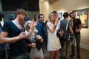 IZZY SCHIMEK, Gallerygoers encouraged to view the work through their cellphones.- low fidelity invader. Lazarides. 11 rathbone place. w1t 1HR