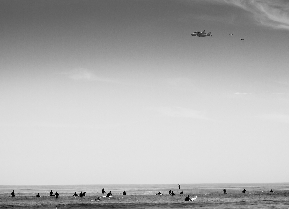 The shuttle Endeavor flies over famed Malibu Beach atop a modified 747 on its final flight to Los Angeles where it will be retired.