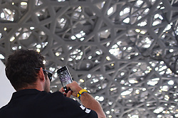 February 23, 2019 - Abu Dhabi, United Arab Emirates - Mark Cavendish of Great Britain and Team Dimension Data, takes pictures inside the Louvre Abu Dhabi Museum..On Saturday, February 23, 2019, Abu Dhabi, United Arab Emirates. (Credit Image: © Artur Widak/NurPhoto via ZUMA Press)