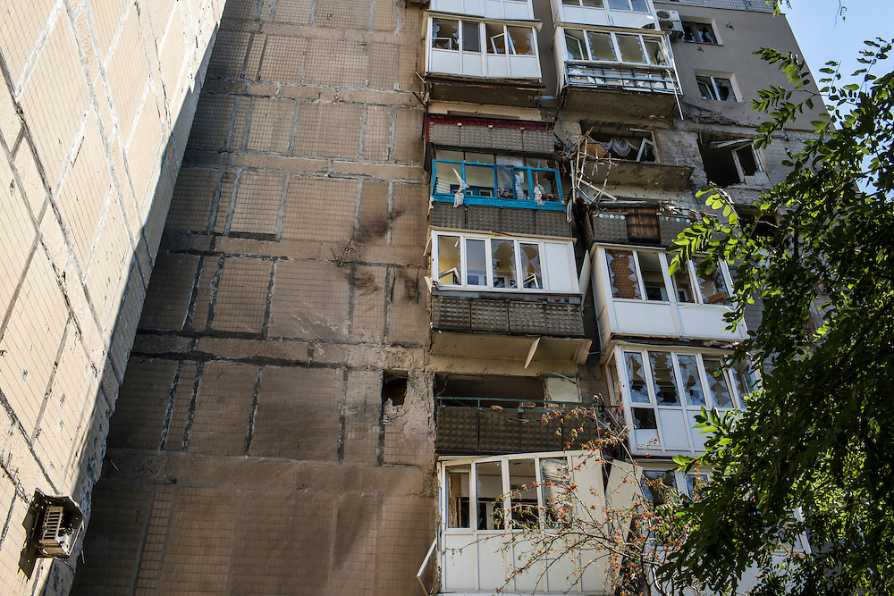 Windows are broken and balconies destroyed in an apartment building that was hit by a supsected grad rocket strike on Tuesday, July 29, 2014 in Donetsk, Ukraine.