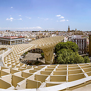 SEVILLE, SPAIN - MAY 2014: Panoramic view in the top of Metropol Parasol in Plaza de la Encarnacion on 31 of May 2014 in Sevilla,Spain. the extraordinary new Seville Market Hall an attractive destination for tourists and locals alike. Projected by J. Mayer H. architects, it is made from bonded timber with a polyurethane coating.