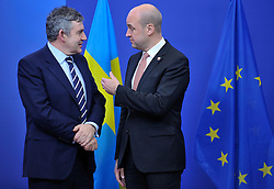 Gordon Brown, the U.K.'s prime minister, left, arrives for the European Union Summit and is greeted by Fredrik Reinfeldt, Sweden's prime minister and standing president of the European Council, at the EU headquarters in Brussels, Belgium, on Thursday, Nov. 19, 2009. European leaders will try to set divisions aside today as they choose their first-ever European Union president to represent the 27-nation bloc on the world stage.(Photo © Jock Fistick).