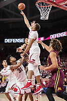 FAYETTEVILLE, AR - DECEMBER 9:  Daniel Gafford #10 of the Arkansas Razorbacks blocks a shot during a game against the Minnesota Golden Gophers at Bud Walton Arena on December 9, 2017 in Fayetteville, Arkansas.  The Razorbacks defeated the Golden Gophers 95-79.  (Photo by Wesley Hitt/Getty Images) *** Local Caption *** Daniel Gafford