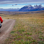 Heather Goodrich riding the Salto Las Chinas trail from Estancia Gemita. On a found kid's bike at the Estancia Geminita over looking the Paine Massive and Los Torres.