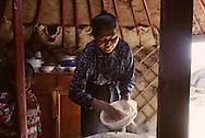 Mongolia. preparing meal in the yurt. in somun argalant  Hoohorlol