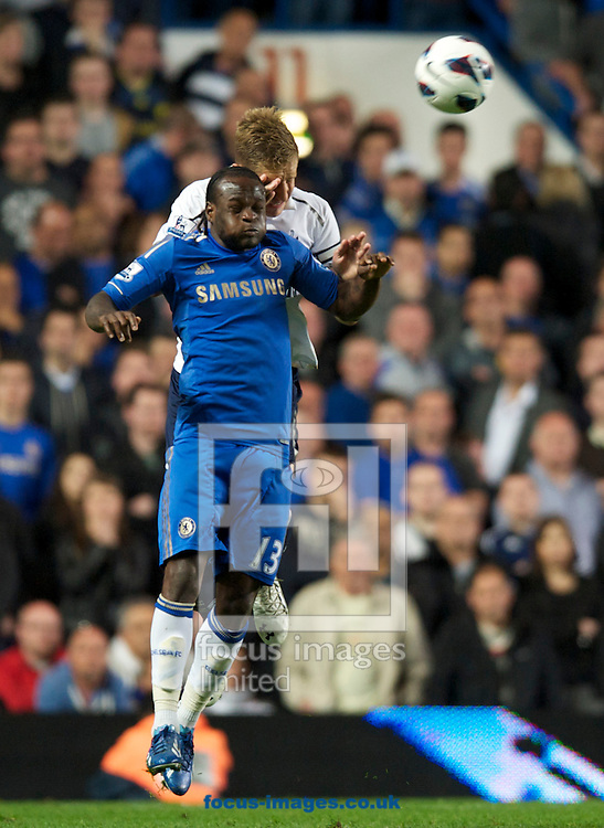 Picture by Alan Stanford/Focus Images Ltd +44 7915 056117.08/05/2013.Victor Moses of Chelsea beats Michael Dawson  of Tottenham Hotspur to the header during the Barclays Premier League match at Stamford Bridge, London..