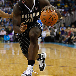 January 12, 2011; New Orleans, LA, USA; Orlando Magic power forward Brandon Bass (30) against the New Orleans Hornets during the second half at the New Orleans Arena. The Hornets defeated the Magic 92-89.  Mandatory Credit: Derick E. Hingle
