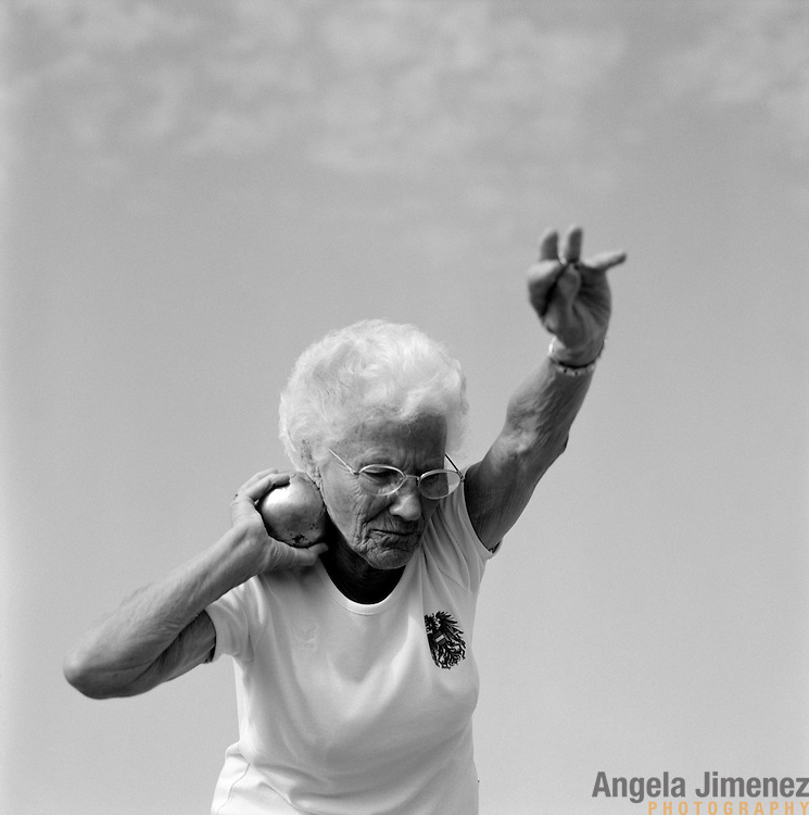 87-year-old masters track &amp; field athlete Elfriede Fuchs, of Judenburg, Austria, is photographed competing in the W85 shot put during the 2007 World Masters Championships Stadia (track and field competition) at Misano Adriatico Stadium in Misano Adriatico, Italy on September 7, 2007.<br /> <br /> 9,000 male and female athletes over the age of 35 from 90 countries competed in two weeks of track and field events at the 17th annual event. The event is run by  the World Association of Masters Athletes, the organization designated by the IAAF (The International Association of Athletics Federations) to conduct the worldwide sport of masters athletics. The organization runs competitions and maintains record standings in the 5-year increment age divisions.  ...