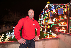 © Licensed to London News Pictures. 01/12/2015. Bristol, UK.  LEE BRAILSFORD at the Brailsford family's Christmas Lights Big Switch On. Brothers Lee and Paul Brailsford have spent 20 years and more than £20,000 building up their huge collection of festive decorations in Bentry, Bristol to turn the home of their mother Rosemary into a winter wonderland every year. They have tens of thousands of lights, a life-size nativity, trains, snowmen, toy soldiers, reindeers, Santas and a snow machine. They raise money from people who flock to see the spectacle and to date they have raised more than £30,000 for charities such as the Wallace and Gromit Appeal that supports Bristol Children's Hospital.  The electricity and replacement lights cost around £1,000 each year, but this year the brothers are trying to convert everything to LED lights to be more efficient for Bristol's year as European Green capital 2015. Photo credit : Simon Chapman/LNP