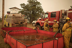 July 26, 2018 - Idyllwild, California, U.S. - Cal Fire Gulf Crew fills water tanks. A wildfire has burned through more than 38,000 acres near Yosemite National Park in California, and it hasn't stopped for two weeks. The Ferguson Fire has continued since the fire started west of Yosemite on July 13, aided by high temperatures and dry air. The wildfire has injured seven firefighters and killed one. (Credit Image: © Cal Fire via ZUMA Wire/ZUMAPRESS.com)