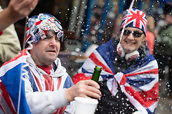 Royal fans celebrate outside Windsor Castle in Berkshire after Buckingham Palace has announced the news of the birth of the Duke and Duchess of Sussex's new baby boy.