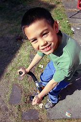 Portrait of young boy riding bicycle smiling,