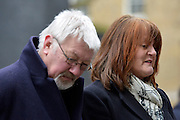 © Licensed to London News Pictures. 28/03/2013. Westminster, UK. (Left - right)   Adrian Thornber, Ann Thornber. Two families, whose 17-years-old sons both committed suicide after being arrested, have joined forces to deliver a petition to Downing Street calling for the law to be changed to protect all children in custody. Nick and Jane Lawton's son Joe took his own life just two days after being arrested for failing a breath test. Adrian and Ann Thornber lost their son Edward after he was wrongly sent a letter to attend court instead of a warning after being caught with 50p worth of cannabis. In both cases the parents had not been informed of the arrest.. Photo credit : Stephen Simpson/LNP