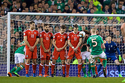 DUBLIN, REPUBLIC OF IRELAND - Friday, March 24, 2017: Wales' Sam Vokes, Joe Ledley, Ben Davies and Gareth Bale form a defensive wall as they face a free-kick from Republic of Ireland's James McClean during the 2018 FIFA World Cup Qualifying Group D match at the Aviva Stadium. (Pic by David Rawcliffe/Propaganda)