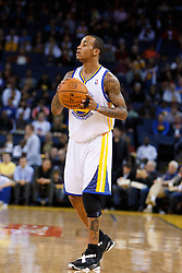 Jan 25, 2012; Oakland, CA, USA; Golden State Warriors shooting guard Monta Ellis (8) holds the ball against the Portland Trail Blazers during the first quarter at Oracle Arena. Golden State defeated Portland 101-93. Mandatory Credit: Jason O. Watson-US PRESSWIRE