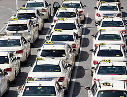 Taxi rank with many taxis queuing at Tegel Airport in Berlin, Germany