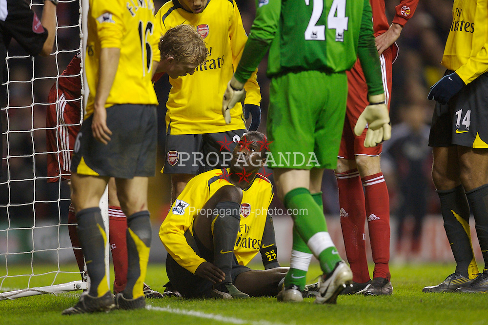 Liverpool, England - Saturday, January 6, 2007: Liverpool's Dirk Kuyt explains to the 'injured' Arsenal's Emmanuel Eboue that he can move only five inches to receive treatment off the pitch if he really is injured, and not playing for time, during the FA Cup 3rd Round match at Anfield. (Pic by David Rawcliffe/Propaganda)