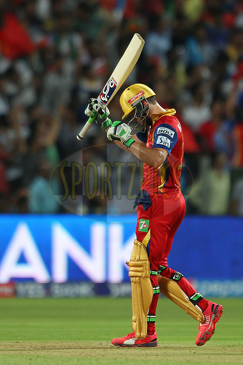 AB De Villiers of the Royal Challengers Bangalore celebrates his fifty during the eliminator match of the Pepsi IPL 2015 (Indian Premier League) between The Royal Challengers Bangalore and The Rajasthan Royals held at the MCA International Stadium in Pune, India on the 20th May 2015.<br /> <br /> Photo by:  Ron Gaunt / SPORTZPICS / IPL