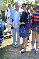 SIR JONATHAN IVE and CHARLOTTE STOCKDALE at the Cartier hosted Style et Lux at The Goodwood Festival of Speed at Goodwood House, West Sussex on 29th June 2014.