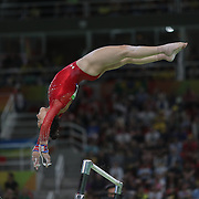Gymnastics - Olympics: Day 6  Alexandra Raisman #395 of the United States in action on the Uneven Bars during her silver medal performance in the Artistic Gymnastics Women's Individual All-Around Final at the Rio Olympic Arena on August 11, 2016 in Rio de Janeiro, Brazil. (Photo by Tim Clayton/Corbis via Getty Images)