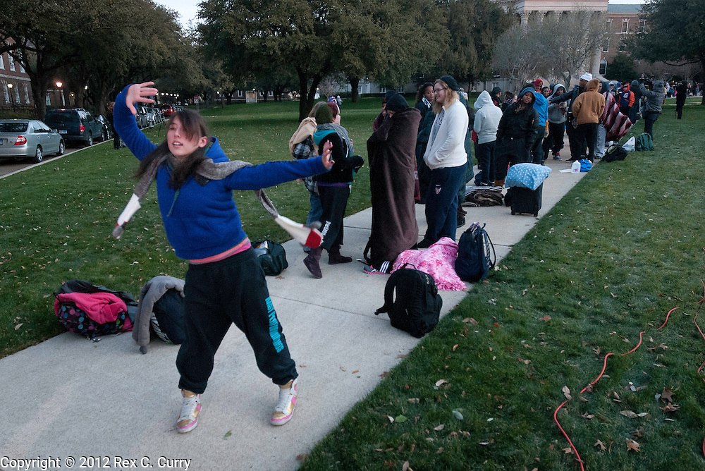 "Emily Tsuknekawa, 22, from Sacramento, Ca. dances while waiting in the early morning cold to audition for ""So You Think You Can Dance"" at SMU on Friday, Jan. 13, 2012."
