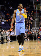 Nov. 12, 2012; Phoenix, AZ, USA; Denver Nuggets guard Andre Iguoldala (9) reacts on the court during the game  against the Phoenix Suns in the first half at US Airways Center. The Suns defeated the Nuggets 110-100. Mandatory Credit: Jennifer Stewart-US PRESSWIRE