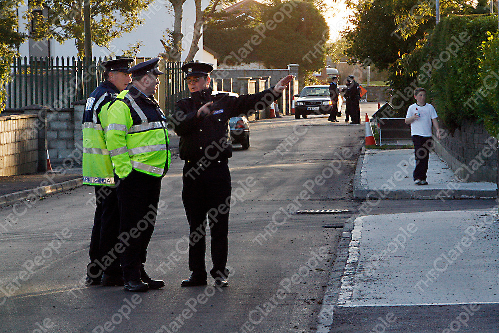 A young local boy is oblivious to the large Garda presence on Crowe Street after a man barricaded himself into his house in Gort on Sunday night.<br />