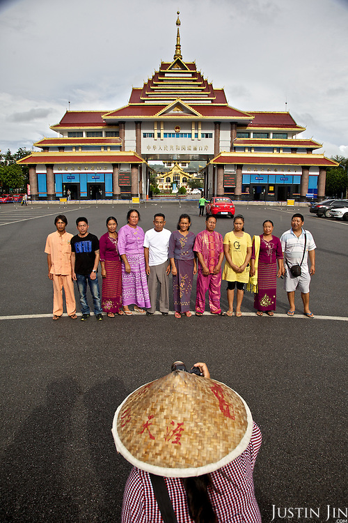 Burmese people take a group photo on the Chinese side of the China-Myanmar border.