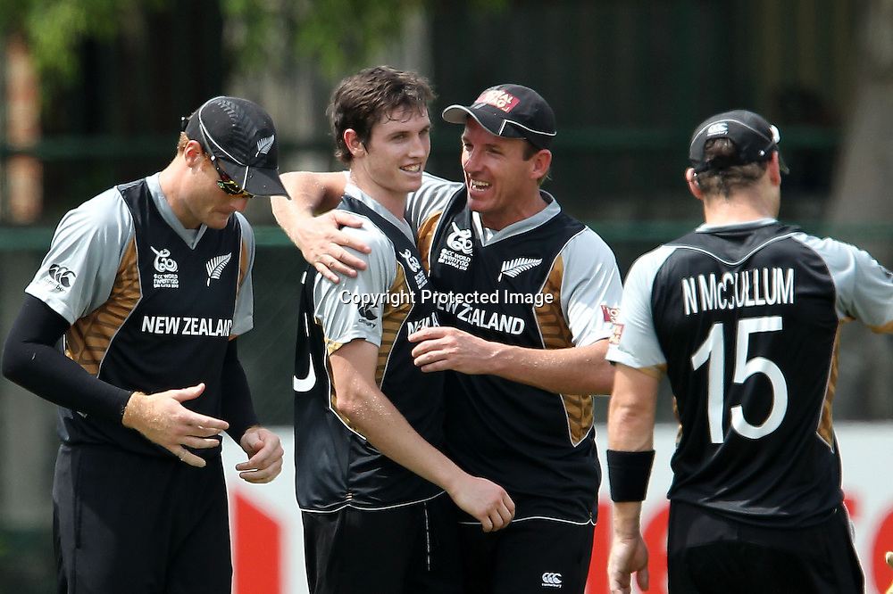 Adam Milne celebrates the wicket of Richard Levi during the ICC Twenty 20 World Cup warm up match between New Zealand and South Africa held at the Colts Cricket Club in Colombo, Sri Lanka on the 17th September 2012<br /> <br /> Photo by Ron Gaunt/SPORTZPICS/PHOTOSPORT