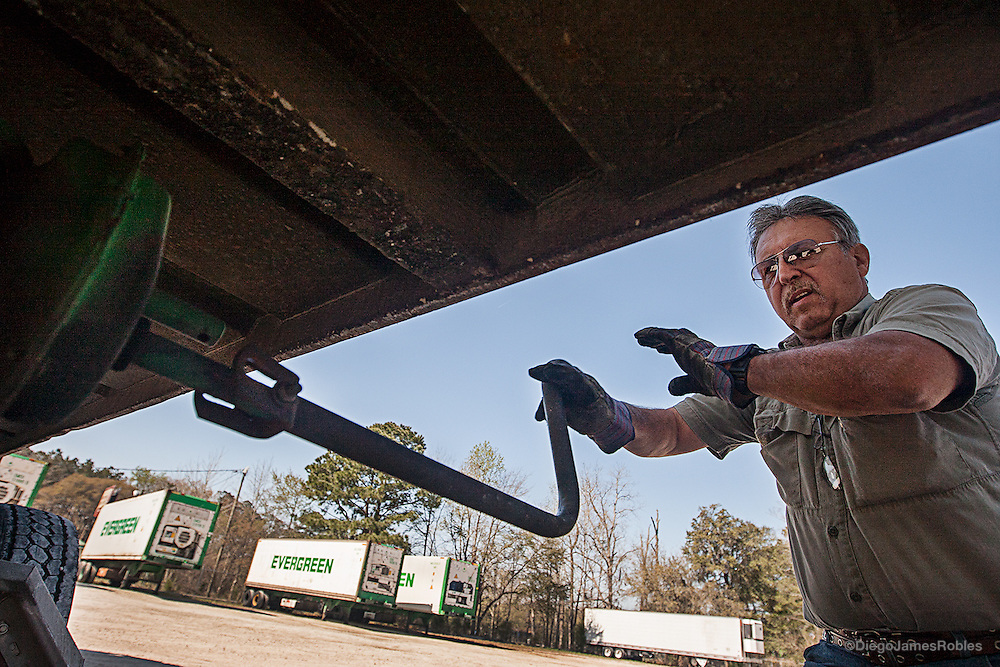 "Joe prepares an empty trailer for pickup from his local storage. ""A truck doesn't go by the year, it goes by condition,"" Joe said referring to the used truck market. He's procured some used rigs for as little as $20,000 and once even $5,000."