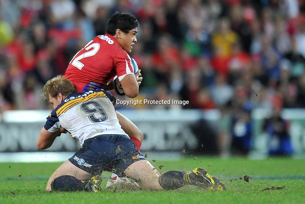 Pat Phibbs tackles Ben Tapuai from behind during action from Super 15 rugby (Round 16) - Reds v Brumbies played at Suncorp Stadium, Brisbane, Australia on Saturday 4th May 2011 ~ Photo : Steven Hight (AURA Images) / Photosport