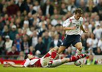 Photo: Aidan Ellis.<br />England v Austria. World Cup Qualifier. 08/10/2005.<br /><br />Michael Owen is tackled by Austria's Paul Scharner.