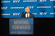 Hempstead, New York, USA. May 23, 2018. New York State Comptroller THOMAS P. DiNAPOLI speaks, accepting party nomination, during Day 1 of New York State Democratic Convention, held at Hofstra University on Long Island. MOVING FORWARD slogan is on poster.