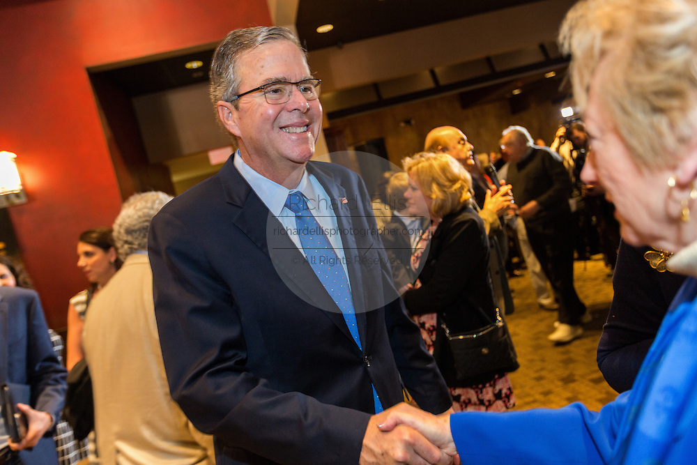 Former Florida Governor and potential Republican presidential candidate Jeb Bush greets supporters at an early morning GOP breakfast event March 18, 2015 in Myrtle Beach, South Carolina.