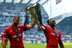 George Kruis of Saracens and Maro Itoje of Saracens celebrate winning the Heineken Champions Cup after beating Leinster Rugby in the Fina - Mandatory by-line: Robbie Stephenson/JMP - 11/05/2019 - RUGBY - St James' Park - Newcastle, England - Leinster Rugby v Saracens - Heineken Champions Cup Final