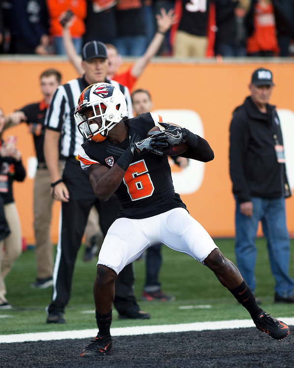 Oregon State's Victor Bolden cradles the ball in the endzone for a touchdown during the Beavers' 26-7 victory over Weber State in the 2015 season opener in Reser Stadium, in Corvallis, on Friday, Sept. 4, 2015.