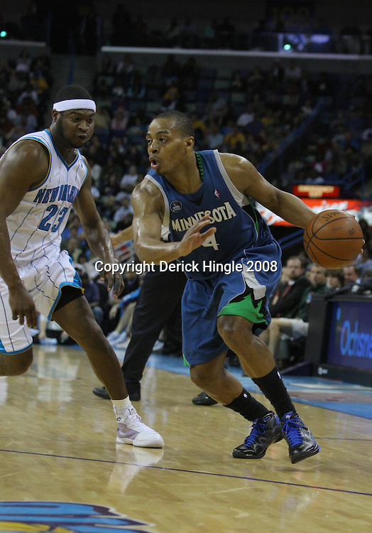 08 February 2009:  Minnesota Timberwolves guard Randy Foye (4) drives past New Orleans Hornets guard Devin Brown (23) during a 101-97 win by the New Orleans Hornets over the Minnesota Timberwolves at the New Orleans Arena in New Orleans, LA.